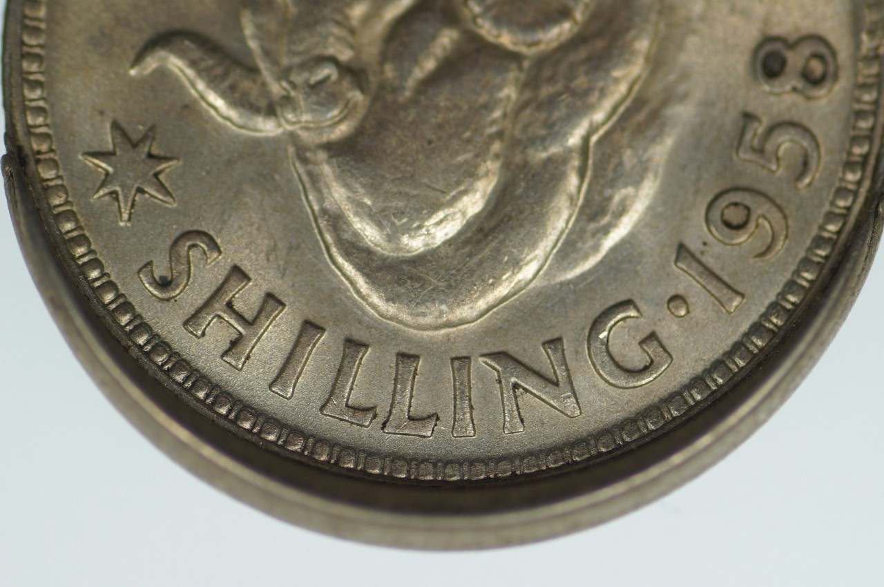 1958 Shilling Variety Error Mis-Strike in Uncirculated Condition Reverse Close Up