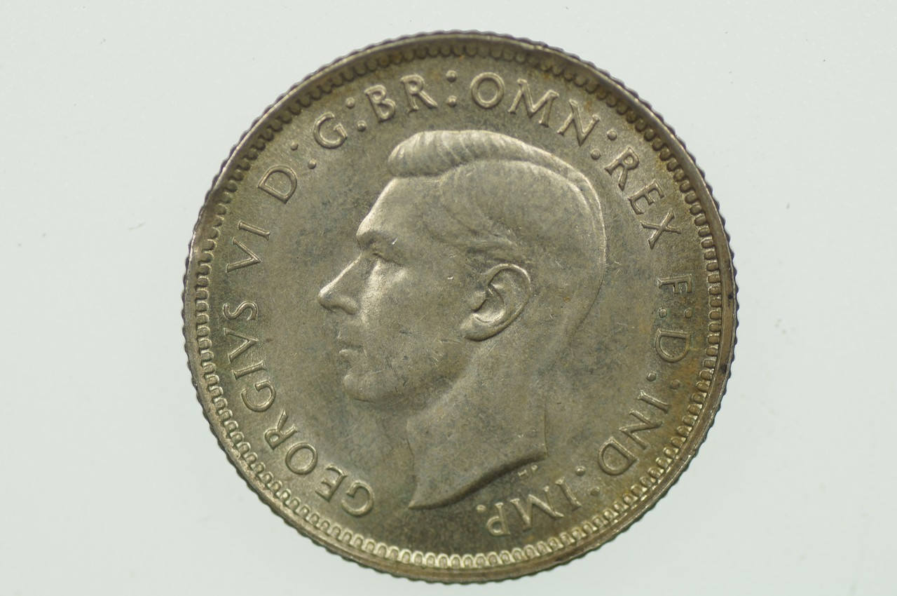1938 Sixpence Variety Error Clipped Edge in Almost Uncirculated Condition Obverse