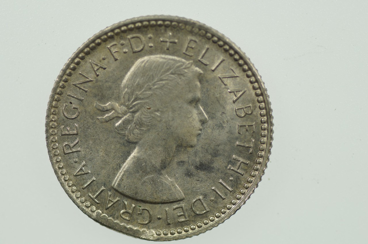 1963 Sixpence Variety Error Clipped Edge in Uncirculated Condition Obverse