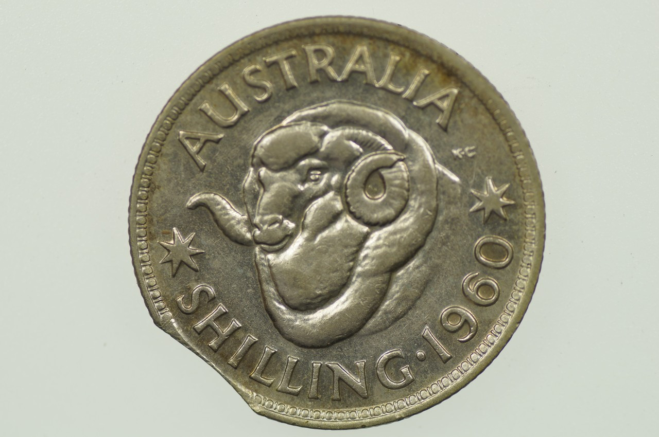 1960 Shilling Variety Error Bitten Edge in Extremely Fine Condition  Reverse