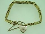9ct Yellow Gold 18 cm Gate Bracelet and Love Heart Locket 21.4 Grams