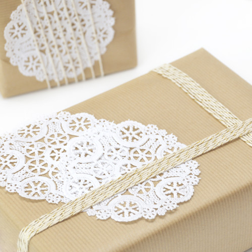 White round lace paper doilies for crafting, weddings and gift wrap