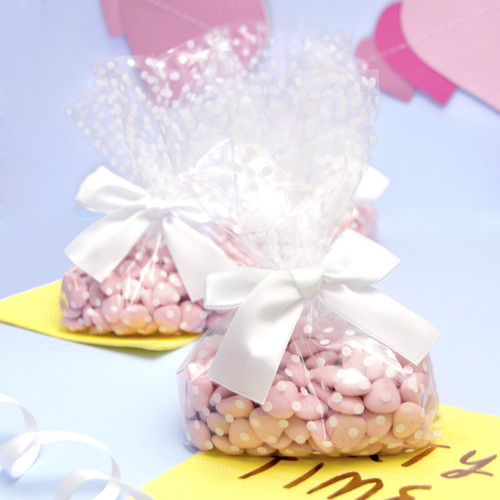 White polka dot wedding favour cellophane sweetie bags for guests desserts, almonds and gifts