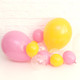 Mini pink and yellow party balloons for wedding and decoration decorations