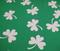 Shamrock fabric sports a medium green background with white shamrocks.