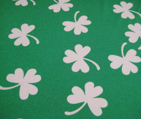 Shamrock fabric sports a medium green background with white shamrocks.