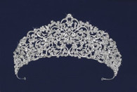 This is a 2 1/2 inches in height. Scrolls, vines and flowers bejeweled with czech rhinestones give this tiara its righteous drama.