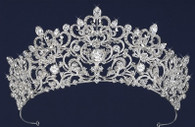 Intricate design of scrolls. Tiara is tipped with 5 teardrop czech rhinestones. 2 1/2 inch in height.