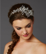 This unique crystal hair vine by Mariell is a fabulous way to light up any room. With hundreds of gleaming crystals and a flexible design for every bridal style! Our tiara vine is plated in Genuine Rhodium and has loops at each for maximum styling options.