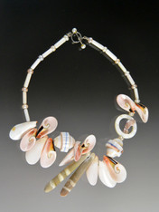 """This delightful collage of seashells, tiny pearls, rare sea urchin spines and pink mother of pearl is perfect for the town, country or seashore.  Very limited.  18"""""""