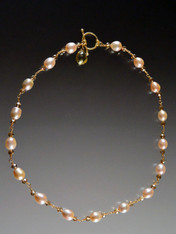 This is a stunning collectible necklace featuring opulent pink pearls and tiny cognac Swarovski crystals wrapped with gold wire and a 14K cast clasp and grade AAA topaz dangle to be worn in the front (or back if you prefer) Note: This clasp was is over 12 years old and is worth at least the cost of the necklace!  Very limited. 18""