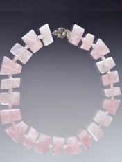 Circle your neck with a delightful glowing pink quartz geometric puzzle pieces.  Versatile and comfortable.  18""