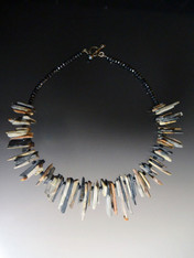 This unique necklace with a strong global vibe goes with everything and features multi tones of matte gray and pale apricot toned apricot shards.  Only 2.  20""