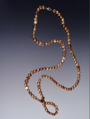 A simple luminous bronze pearl freeform rope to wear long or double as you desire.  48""