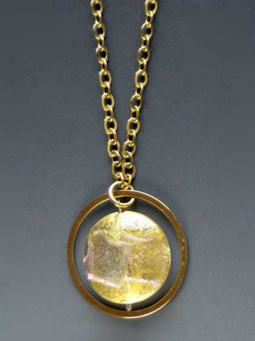 "Make a dramatic statement with this dichroic* Venetian glass disc pendant with sparks of petal, silver and gold) suspended from a 24K ultraplate hoop (2"") and looped chain 30"""