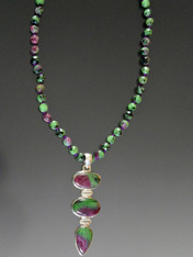 "If you like to wear multiple delicate necklaces and tell a color story you will love this piece. It features a glowing 3 cabochon ruby zoisite sterling silver pendant on a chain of silk-hand-knotted ruby zoiste beads. 20"" 2.5 pendant"