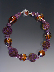 You won't see anything like this anywhere!  It's my favorite in the entire collection.  This showstopper features glistening titanium coated Brazilian wine Druzy discs, step cut ruby rondels, and no longer available amber ruby Venetian sasso beads.  Plus a stunning Baltic Amber Silver  clasp 21""