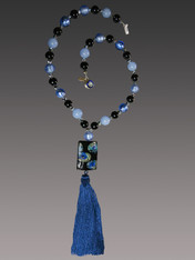 "This stunning on trend necklace features a ""Van Gogh"" limited edition blue Starry Night Venetian glass rectangle with silk-knotted indigo,pale blue, and biack Venetian glass beads, a luxurious blue silk tassel, and a gold druzy sterling clasp.   Necklace 30"" Silk Tassel 4-1/2""  ONLY THREE AVAILABLE      *This authentic lampwork Murano Glass Bead is one of a kind, big and bold made with amazing skill and time. Named ""VanGogh"" because the little paintings inside look like scenes from the paintings, they measure almost 2 inches in length, and the pattern is always different owing to the handwork. This particular bead features shades of black, luminous starry blue, and aqua."