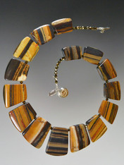 If you favor earth tones and interesting patterns, this versatile tiger iron jasper fitted geometric collar spaced with tiny complementary Swarovski crystals will go with everything in your wardrobe all year round. 18""