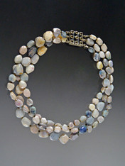 This subtle elegant torsade of multi-toned gray pebble opals spaced with tiny Swarovski crystals is perfect for day or evening wear.