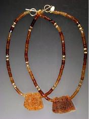 "A dramatic Brazilian druzy pendant with a circle of hessionite garnet. 18"""