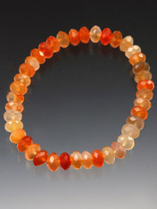 A delicate sparkling stretch bracelet of faceted carnelian rondels.  Wear alone or pair with others.