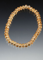 This sparkling stretch bracelet of faceted grade AA citrine rondels is perfect alone or paired with others.