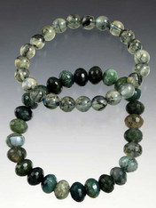 """Two bracelets in all the shades of green - one faceted green agate, the other quartz with tourmaline needle inclusions. Pair, wear solo, or stack with others. Stretches to 8"""""""