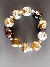 """Faceted multi-jasper balls in tones of white, bronze, gold and brown with Alabaster Swarovski crystals. Stretches to 8"""""""
