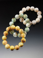 Luminous natural mother-of-pearl stretch bracelets in three versatile colors: Choose ivory, light aqua, or banana.