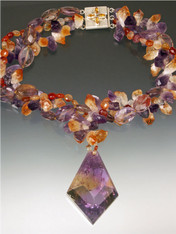 "A spectacular 2"" x 2"" faceted ametrine pendant falls from a raw amethyst, citrine and carnelian 20"" torsade.  ONE OF A KIND"