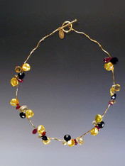 "Affordable luxury just for you. The newest in my line of precious cluster collars features dramatic yet delicate precious gemstones in autumn hues of Grade AAA citrine, black tourmaline, ruby and delightful gold petal pearls with14K vine shaped beads and a 14K clasp.   17-1/2"" (Longer lengths available on request)"