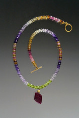 This elegant collar features alternating precious gemstone rondels of citrine, peridot, tourmaline, garnet, a cast 14K clasp and ruby dangle