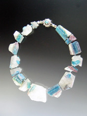 "If you appreciate rare natural wonders, you will grab this amazing natural Brazilian Paraiba Tourmaline* necklace spaced with Japanese double silk knots and finished with a custom peruvian opal sterling clasp.17""  I bought this many years ago from a Brazilian rare gem specialist not knowing exactly what it was but enthralled by the raw beauty of it.  I have since learned that Paraiba tourmaline in its polished form is one of the most valuable gemstones in the world, selling for over $10,000 a karat."