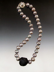 Totally spectacular!! Huge 16mm natural gray/mauve south sea pearls frame a Brazilian black onyx centerpiece. Hand-knotted with double Japanese-style silk knots.  Custom mabe pearl sterling clasp. 18""