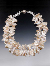 "WOW!  If you love pearls, if you love drama and opulence, this is it! Perfect for a wedding or opening night gala. Several years ago I found two strands of these incredibly luminous freeform pearls, one in pale blossom pink, the other silver white.  Each pearl is HUGE -some almost 2"" This looks like a double strand but it's actually one strand.  Tiny Swarovski crystal stations give it an extra sparkle and a pearl sterling clasp complete the picture.  19""  Choose pale blossom or silver white (not pictured)."