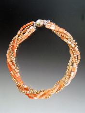 A Website Best Buy! Slip on this orangeade delight and wear it with anything - casual to dressup.  Three strands of orange aventurine in  shades of pale blush to deep orange, 2 strands of peach freshwater pearls spaced with sparkling Swarovski crystals held by a custom clasp completes the picture.  This will become your wardrobe staple. Only 6 pieces!!  19""
