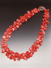 Make a dramatic statement wearing this  peach coral collar!