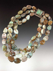 Three strands of subtly shaded Peruvian opal with choice of clasp.