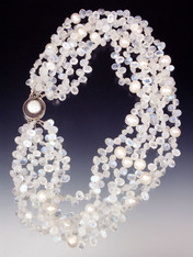 Want a collar of white diamonds? These are just as dazzling and more interesting! 14mm white pearls float on clouds of faceted rainbow moonstone with flashes of blue and white ice.  Superb quality. Only three or four strands available. 20""