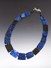 A rare and unusual fitted collar of the finest quality Grade AAA lapis and onyx slices - You get two looks in one -- Rough and smooth!   One side is raw showing all the amazing natural patterns - the other highly polished with stunning deep cobalt blue and black.  18""