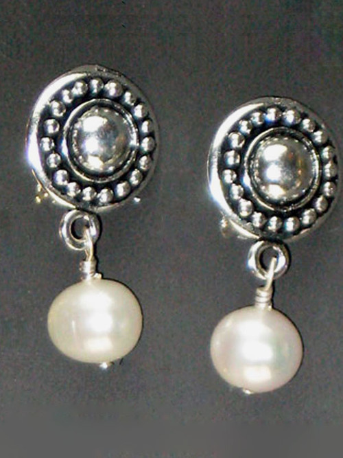 """Now you can have the finest quality pearl earrings in clips. This elegant design features circle pattern Terracast sterling buttons and Grade AAA perfect round milky white freshwater pearls. Super light and elegant 1"""""""