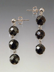 "A 1-1/2"" cascade of with faceted hematite balls with sterling silver post"