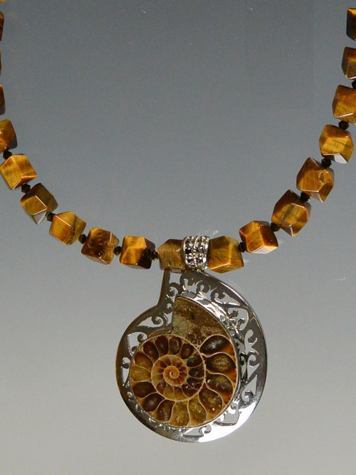 Ammonite sterling silver pendant tiger eye necklace make a statement with this faceted tiger eye necklace and ammonite pendant set infiligree sterling silver aloadofball Images