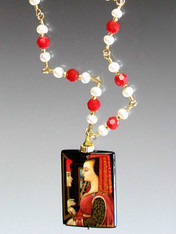 This one of a kind pendant features a famous Flemish painting of two lovers confessing their affection.  The pendant is handpainted with 24K gold overlay and the chain is linked pearls and red coral.  24""