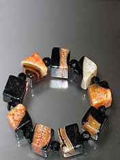 This geometric cube bracelet in seasonal agate colors makes a strong statement. Stretches to 8""