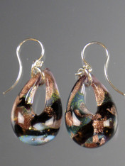 These teardrop earrings feature authentic Murano Glass with a base of Celeste Aqua glass with Gold and silver foil, black and taupe, then encased in clear glass with flecks of gold and silver. They are rich in color, each one slightly different as they are entirely handmade. The mound of clear Murano Glass over the color give sit a magnified effect. Sterling Silver Earwires. 1-1/2""