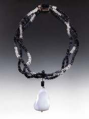 """A fabulous necklace of twisted iolite strands ranging from pale to navy blue. Wear with or without a removable faceted raw calcedony pendant. 19"""""""