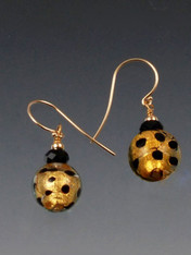 These earrings feature topaz-gold spotted Venetian glass balls with Swarovski crystals.