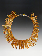"You won't see anything like this one of a kind dramatic ""bib"" collar featuring the finest quality ultra thin natural bronze coral sticks.  19"" Sticks average 2"" in length"